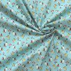 Tissu en 100% coton imprimé pivert sur fond bleu givré