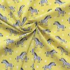 Tissu en 100% coton imprimé zèbre sur fond moutarde