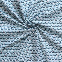 Tissu en 100% coton imprimé baleine et poissons sur fond bleu ciel