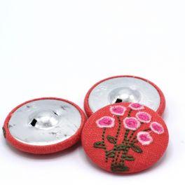 Bouton recouvert en tissu corail motif à fleur