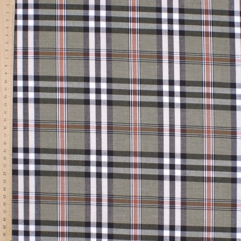 Blue and white checked cotton fabric on grey background