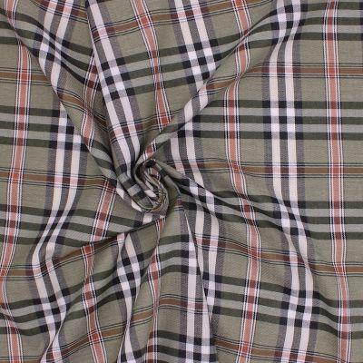 Tissu en coton à carreaux bleu et blanc sur fond gris