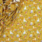 Tissu jersey à motifs sur fond moutarde