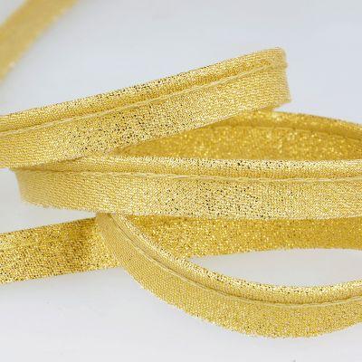 blinkend gouden paspelband