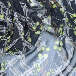 Polyester veil fabric with white dots on black background