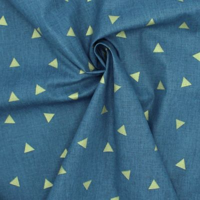 Cotton cretonne with gold-colored triangles on a white background