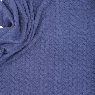 Tissu jersey matelassé à motif torsade bleu