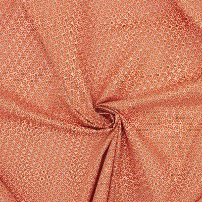 Tissu en coton à motifs origami blanc sur fond orange brûlée