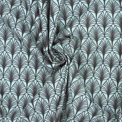 Tissu en coton imprimé sur fond vert eau