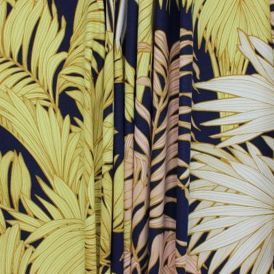 Tissu imprimé végétal sur fond bleu