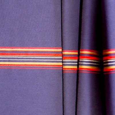 Polyamide fabric with red and beige lines on blue background