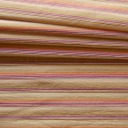 Polyamide fabric with orange, white and pink lines on beige background
