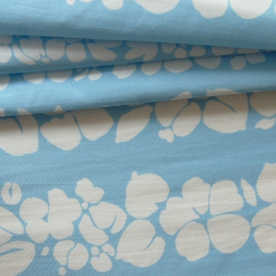 Polyamide fabric with white flowers on blue background
