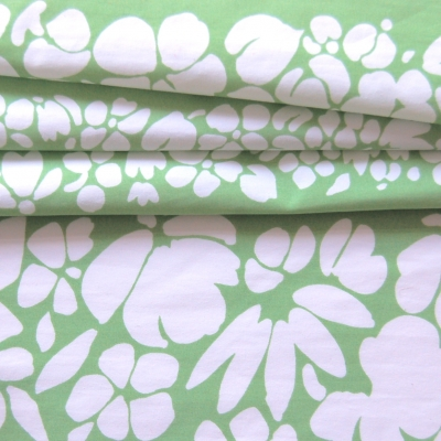 Polyamide fabric with white flowers on green background