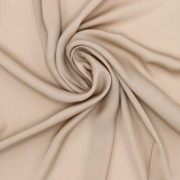 Tissu en satin léger beige