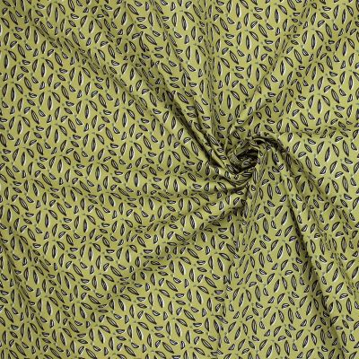Tissu cretonne imprimé sur fond anis