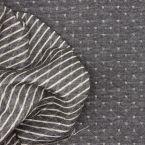 Sweatshirt fabric printed with dark grey shiny stars on a light gray background