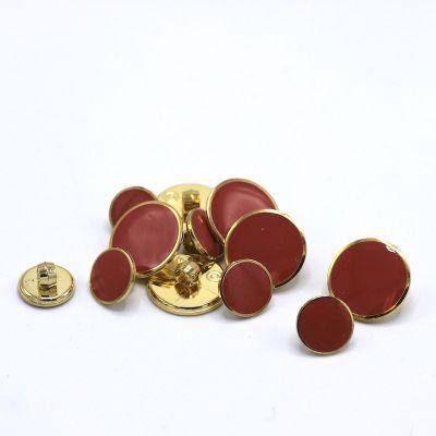 Bouton  aspect métal doré et rouge tomette