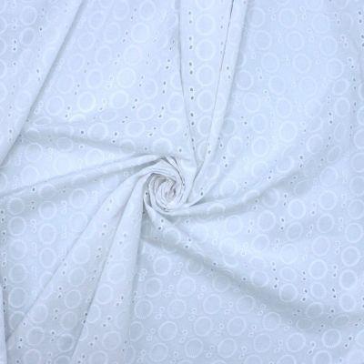 Tissu en broderie anglaise blanc