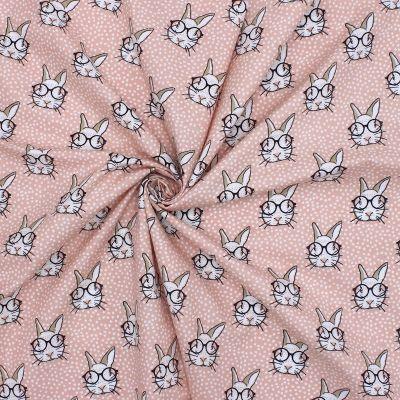 Tissu en coton saumon imprimé têtes de lapins