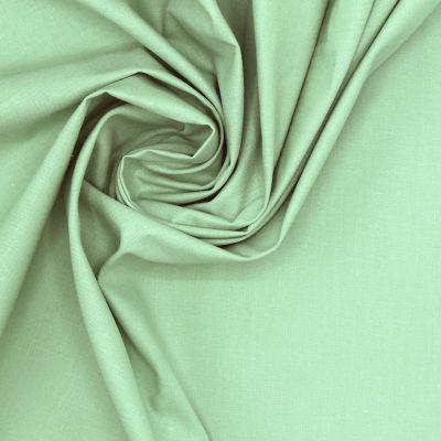 Tissu 100% coton uni vert amande