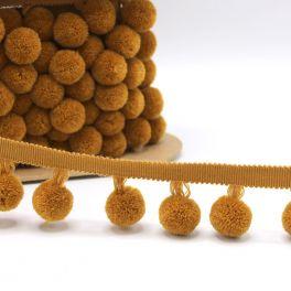 Fantasie biesband met pompons - mosterdgeel