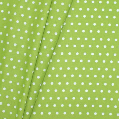 Coated cotton with spots - green anise background
