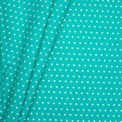 Coated cotton with spots - turquoise background