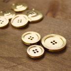 Bouton rond aspect métal doré