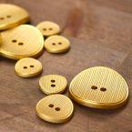 Knoop met metaal aspect - goud