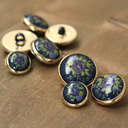 Button with metal aspect - gold and prussian blue