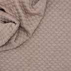 Tissu jersey à motif relief beige rosé