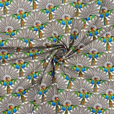 Tissu en coton perroquet sur fond blanc