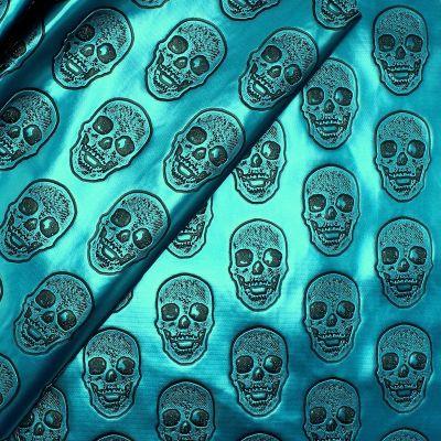 Simili cuir à têtes de mort sur fond bleu