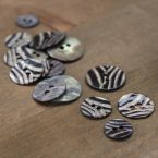 Vintage pearly button with zebra stripes