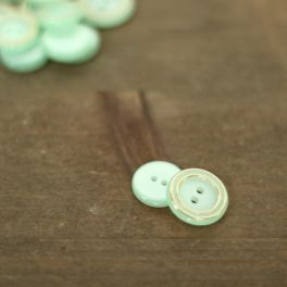 Resin button - sea green and gold