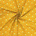 Tissu en coton à motif sur fond moutarde