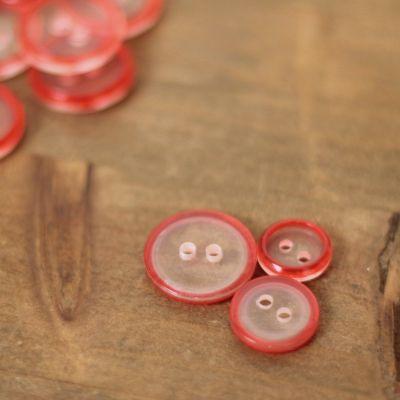 Bouton rouge et transparent