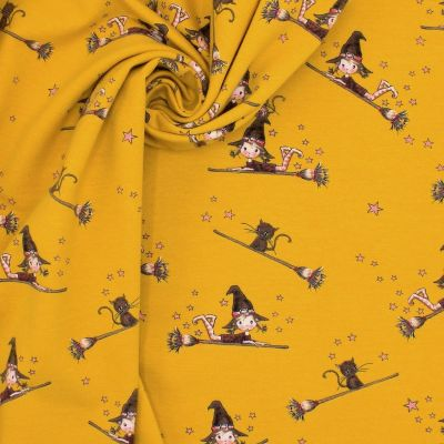 Jersey fabric with witches - mustard yellow
