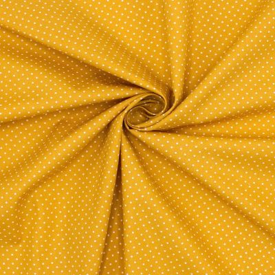 Tissu en coton à pois sur fond moutarde