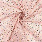 Coton imprimé et à plumetis sur fond rose