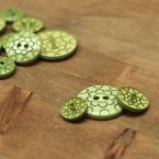 Resin button - green with flower pattern