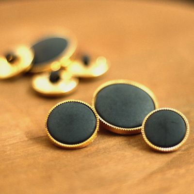 Round button with golden metal aspect - midnight blue