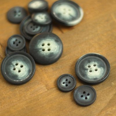Bicolore resin button