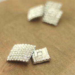 Bouton aspect métal à strass