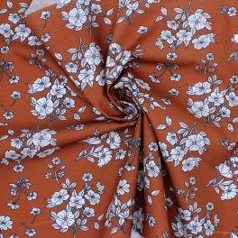 Tissu cretonne à fleurs sur fond rouille