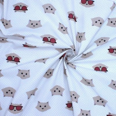 Cotton with prints of beige cat heads