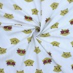 Cotton with prints of mustard yellow cat heads