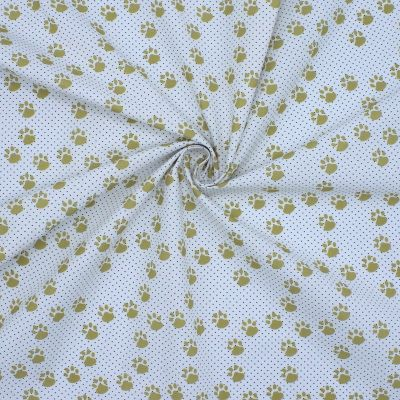 Cotton with prints of mustard yellow small paws