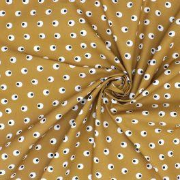Tissu en coton imprimé sur fond moutarde